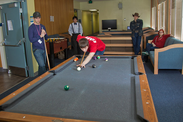 """Junior computer science major Quinn Verfaillie plays some pool with other residents in the Skarland Hall lounge.  <div class=""""ss-paypal-button"""">Filename: LIF-12-3322-011.jpg</div><div class=""""ss-paypal-button-end"""" style=""""""""></div>"""