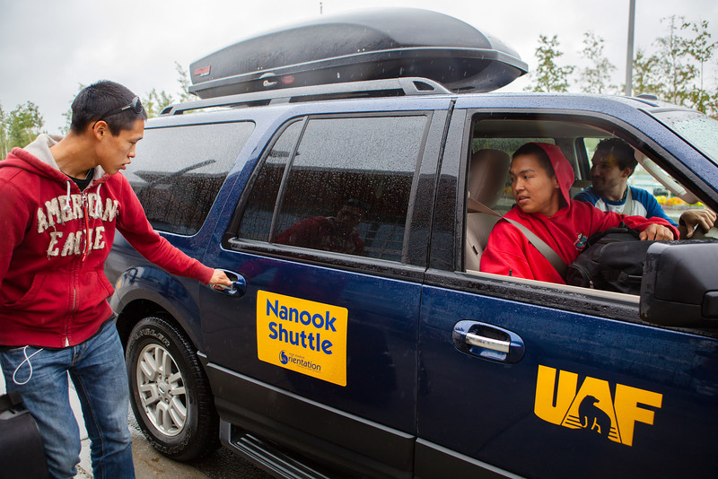 """Joel Jones, left, boards the Nanook Shuttle provided by New Student Orientation after recently arriving from his village in Chevak, Alaska with his friends Lawrence Matchian, right, and Aaron Ulroan, not photograhed, Sunday, August 26, 2012 at the Fairbanks International Airport.  <div class=""""ss-paypal-button"""">Filename: LIF-12-3511-159.jpg</div><div class=""""ss-paypal-button-end"""" style=""""""""></div>"""