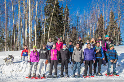 Participants in the second annual Troth Yeddha' Snowshoe Run line up for a group photo after the race Saturday, March 1 by the Reichardt Building. The event hopes to build awarness for a proposed park to help celebrate Alaska's Native culture.  Filename: LIF-14-4079-87.jpg