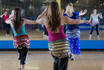 The students of the middle eastern dance class learn how to isolate and roll their hips from instructor Susan Chapa.  Filename: LIF-11-3194-57.jpg
