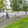 "A students walks her bike towards the library on the first day of the fall 2013 semester on the Fairbanks campus.  <div class=""ss-paypal-button"">Filename: LIF-13-3928-3.jpg</div><div class=""ss-paypal-button-end"" style=""""></div>"