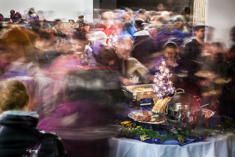 """A holiday gathering hosted by UAF Chancellor Brian Rogers and wife, Sherry Modrow, brought together UAF students, faculty, staff, and Fairbanks community members to share good will and good food at the Wood Center multilevel lounge.  <div class=""""ss-paypal-button"""">Filename: LIF-12-3674-11.jpg</div><div class=""""ss-paypal-button-end"""" style=""""""""></div>"""