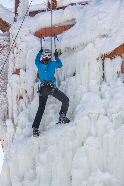 """Students take advantage of nice spring weather to try out their climbing skills on the new ice wall near the SRC.  <div class=""""ss-paypal-button"""">Filename: LIF-12-3321-120.jpg</div><div class=""""ss-paypal-button-end"""" style=""""""""></div>"""