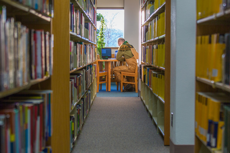 """Senior math major David Leonard catches up on some studying on the 5th floor of the Rasmuson Library.  <div class=""""ss-paypal-button"""">Filename: LIF-14-4045-21.jpg</div><div class=""""ss-paypal-button-end"""" style=""""""""></div>"""