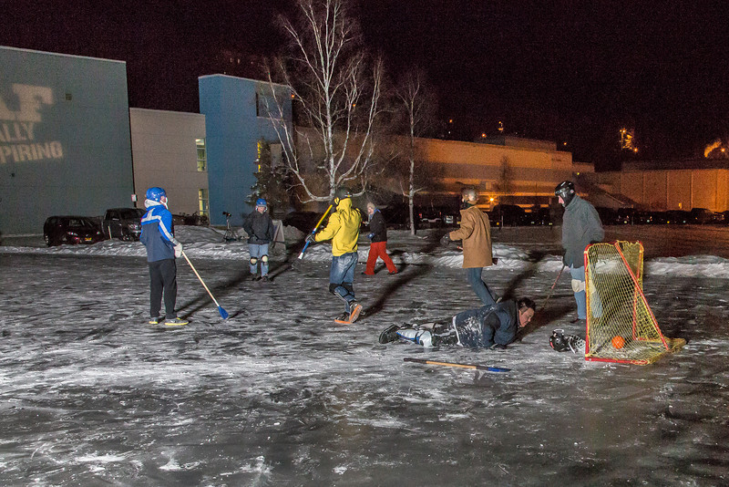 """Outdoor broomball, played on the ice in front of the SRC, is a popular intramural sport at UAF.  <div class=""""ss-paypal-button"""">Filename: LIF-12-3652-91.jpg</div><div class=""""ss-paypal-button-end"""" style=""""""""></div>"""