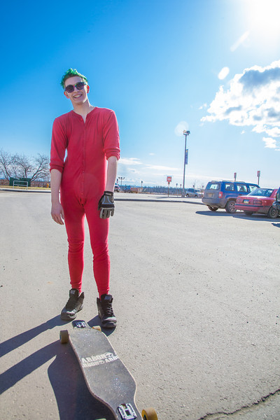 """Andrew Walsh skates around campus in his red onesie.  <div class=""""ss-paypal-button"""">Filename: LIF-12-3360-11.jpg</div><div class=""""ss-paypal-button-end"""" style=""""""""></div>"""