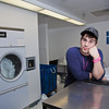 "Freshman Robert Doerning takes time to do laundry in Skarland Hall.  <div class=""ss-paypal-button"">Filename: LIF-12-3322-090.jpg</div><div class=""ss-paypal-button-end"" style=""""></div>"