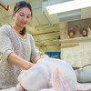 "Emily Blurton stuff turkeys in the ceramics lab in the UAF Fine Arts complex. The birds are covered in clay and then baked in a kiln before being served up during a feast for hungry students on campus over Thanksgiving break.  <div class=""ss-paypal-button"">Filename: LIF-12-3659-18.jpg</div><div class=""ss-paypal-button-end"" style=""""></div>"