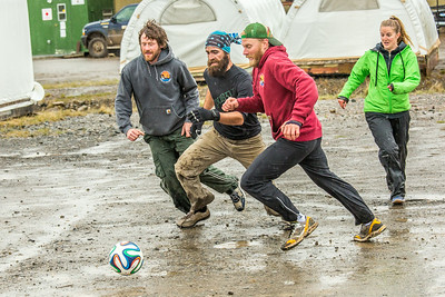 It's staff members versus student researchers from Lab 1 during a wet and muddy soccer match on a summer night at UAF's Institute of Arctic Biology's Toolik Field Station on Alaska's North Slope.  Filename: LIF-14-4216-137.jpg