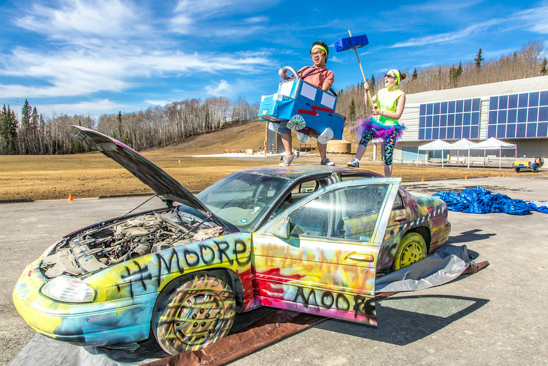 """Moore Hall residents Daniel Nero and Kaitlin Dault goof around on a car before its demolished during UAF SpringFest April 26.  <div class=""""ss-paypal-button"""">Filename: LIF-14-4168-6.jpg</div><div class=""""ss-paypal-button-end""""></div>"""