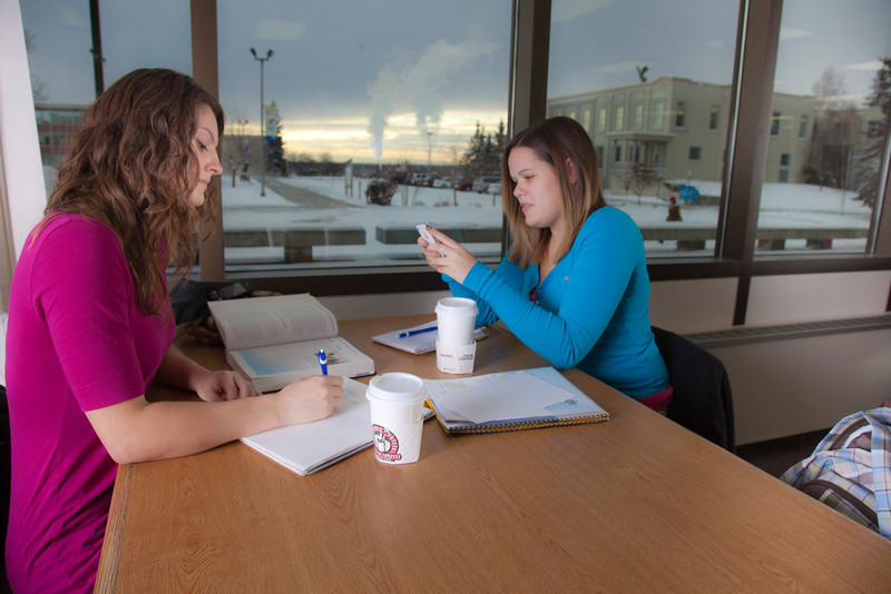 "UAF students Megan Gilmore and Ashley Bartolowits sit with their cofee and study materials in the 24-hour study area of the Rasmuson Library.  <div class=""ss-paypal-button"">Filename: LIF-11-3212-057.jpg</div><div class=""ss-paypal-button-end"" style=""""></div>"