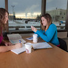 """UAF students Megan Gilmore and Ashley Bartolowits sit with their cofee and study materials in the 24-hour study area of the Rasmuson Library.  <div class=""""ss-paypal-button"""">Filename: LIF-11-3212-057.jpg</div><div class=""""ss-paypal-button-end"""" style=""""""""></div>"""