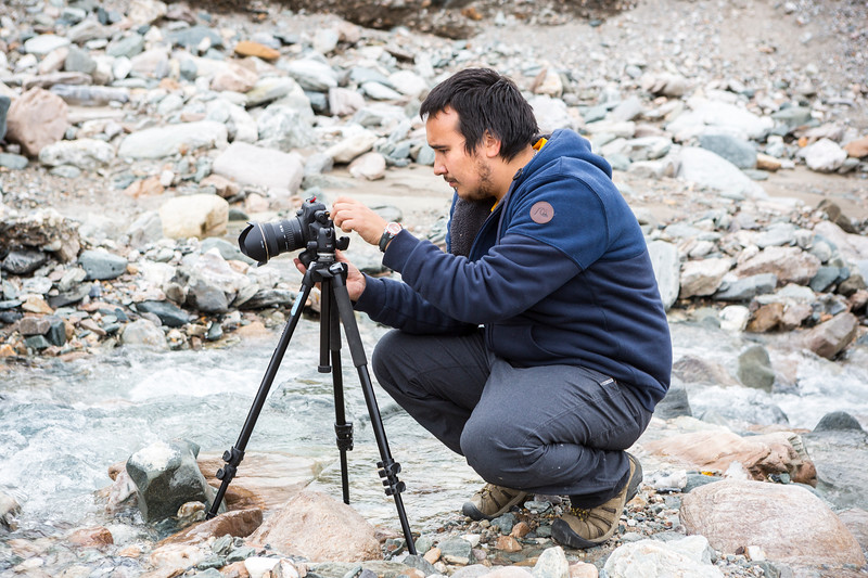 "Baxter Bond adjusts his camera settings and composes his image in Whistler Creek for the Frozen Lenses Landscape Photography Workshop he led on Saturday, Sept. 15, 2018.  <div class=""ss-paypal-button"">Filename: LIF-18-5931-77.jpg</div><div class=""ss-paypal-button-end""></div>"