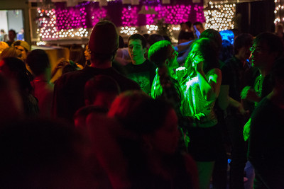 Students boogie with the music at a Mardi Gras themed dance at the Hess Rec. Center on campus.  Filename: LIF-13-3740-57.jpg