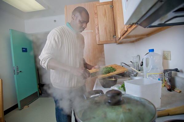 """Peter Ikewun, a petroleum engineeering graduate student from Nigeria, prepares a traditional African soup in his communal Wickersham Hall kitchen.  <div class=""""ss-paypal-button"""">Filename: LIF-12-3268-042.jpg</div><div class=""""ss-paypal-button-end"""" style=""""""""></div>"""