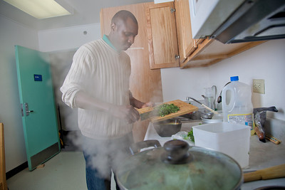 Peter Ikewun, a petroleum engineeering graduate student from Nigeria, prepares a traditional African soup in his communal Wickersham Hall kitchen.  Filename: LIF-12-3268-042.jpg