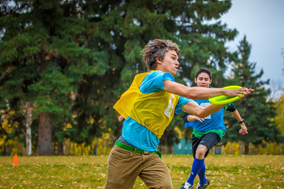 Mechanical engineering major Adam McCombs makes a tough catch during a bout of utlimate frisbee in the field near the University of Alaska's Museum of the North on a fall afternoon.  Filename: LIF-12-3557-124.jpg