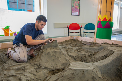 Luis Arauz participated in a promotional sand castle building competition during the spring semester in the Lola Tilly Commons.  Filename: LIF-12-3329-45.jpg