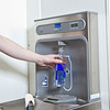 "Students take advantage of a free drinking water dispenser in Wood Center aimed at reducing the number of plastic bottles that end up in the Fairbanks landfill.  <div class=""ss-paypal-button"">Filename: LIF-11-3215-07.jpg</div><div class=""ss-paypal-button-end"" style=""""></div>"