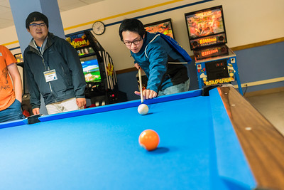 Students relax over a game of pool in the Wood Center during Orientatation Week at the start of the fall 2015 semester.  Filename: LIF-15-4638-016.jpg