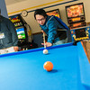 "Students relax over a game of pool in the Wood Center during Orientatation Week at the start of the fall 2015 semester.  <div class=""ss-paypal-button"">Filename: LIF-15-4638-016.jpg</div><div class=""ss-paypal-button-end""></div>"