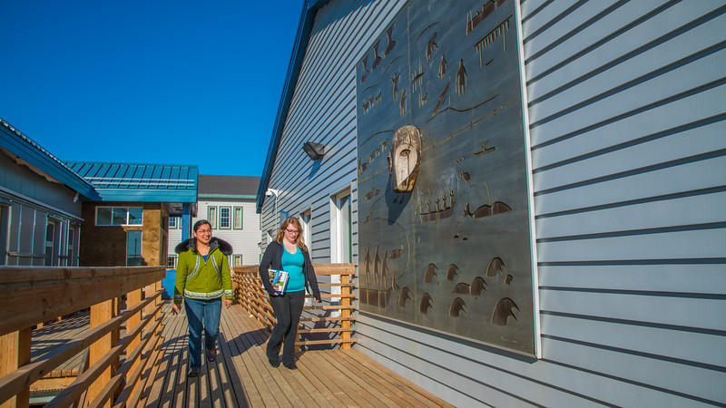 "Students Alyssa Wols, left, and Marjorie Tahbone walk between buildings at UAF's Northwest Campus in Nome.  <div class=""ss-paypal-button"">Filename: LIF-16-4865-238.jpg</div><div class=""ss-paypal-button-end""></div>"