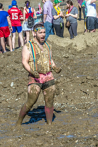A participant in the 2014 SpringFest mud volleyball bouts celebrates a point.  Filename: LIF-14-4167-20.jpg