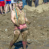 "A participant in the 2014 SpringFest mud volleyball bouts celebrates a point.  <div class=""ss-paypal-button"">Filename: LIF-14-4167-20.jpg</div><div class=""ss-paypal-button-end""></div>"