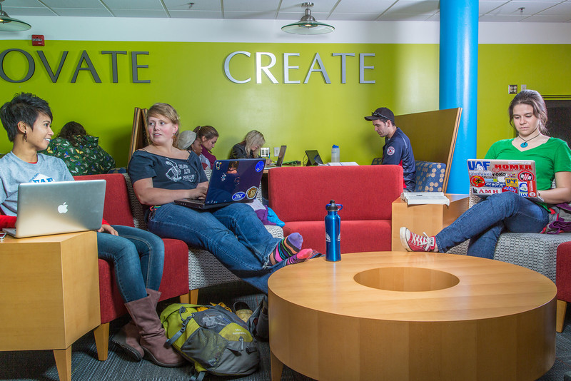 """Students mingle and study in the Nook computer lounge in the Bunnell Building on the Fairbanks campus.  <div class=""""ss-paypal-button"""">Filename: LIF-13-3987-29.jpg</div><div class=""""ss-paypal-button-end"""" style=""""""""></div>"""