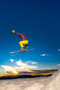 Students enjoy some of the features of UAF's terrain park on a spring afternoon.  Filename: LIF-13-3746-57.jpg