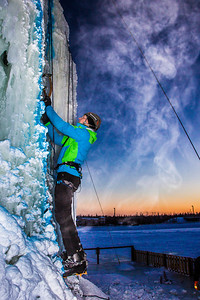 Nick Janssen starts his climb up the tower during the ice climbing competition, offered as part of the 2014 UAF Winter Carnival.  Filename: LIF-14-4084-13.jpg