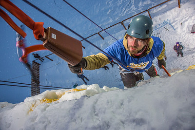 Recent graduate Jason Thies rings the cowbell after his climb up the ice wall in less than a minute during a competition on March 1.  Filename: LIF-13-3748-74.jpg