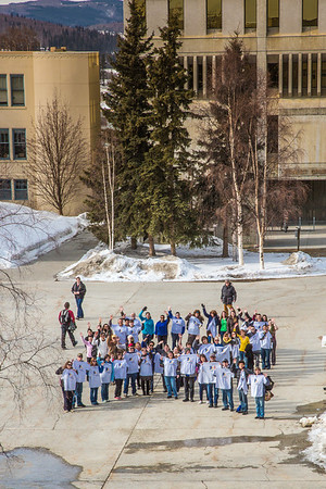 Staff, faculty and students from UAF's School of Education form a human ribbon on a campus sidewalk to draw attention during National Autism Awareness week.  Filename: LIF-13-3776-12.jpg