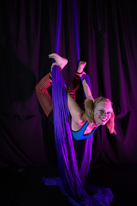 Teal Rogers is an active member of the silk club at UAF, in which members perform acrobatic stunts hanging from silks.  Filename: LIF-14-4133-109.jpg