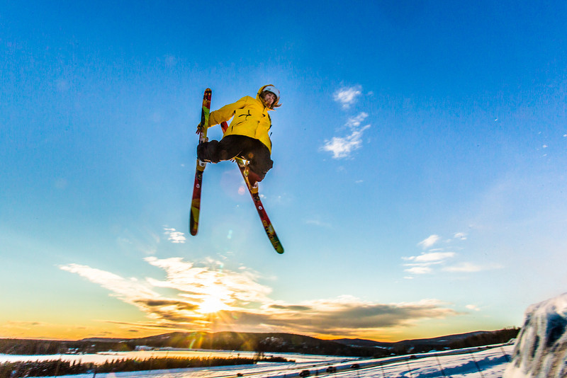 """Students enjoy some of the features of UAF's terrain park on a spring afternoon.  <div class=""""ss-paypal-button"""">Filename: LIF-13-3746-45.jpg</div><div class=""""ss-paypal-button-end"""" style=""""""""></div>"""