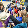 """Incoming students offer found hats to Student Organization Coordinator Josh Hovis at a game of scavenger hunt during the New Student Orientation.  <div class=""""ss-paypal-button"""">Filename: LIF-13-3924-225.jpg</div><div class=""""ss-paypal-button-end"""" style=""""""""></div>"""