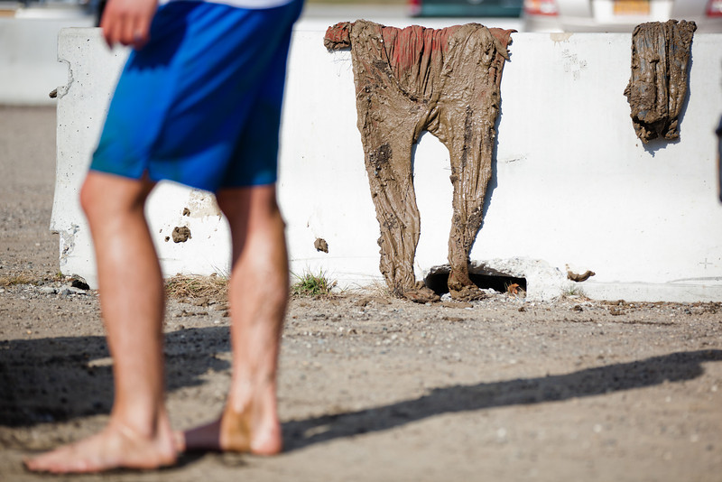 """Students participating in the 2012  Spring Fest's Mud Volleyball tournament clean up the mud on their bodies and clothes.  <div class=""""ss-paypal-button"""">Filename: LIF-12-3378-39.jpg</div><div class=""""ss-paypal-button-end"""" style=""""""""></div>"""