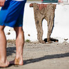 "Students participating in the 2012  Spring Fest's Mud Volleyball tournament clean up the mud on their bodies and clothes.  <div class=""ss-paypal-button"">Filename: LIF-12-3378-39.jpg</div><div class=""ss-paypal-button-end"" style=""""></div>"