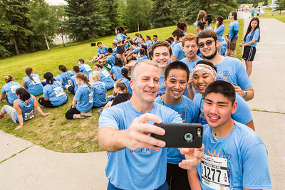 Senator Dan Sullivan takes a selfie with 2016 Rural Alaska Honors Institute participants before the Midnight Sun Run on campus.  Filename: LIF-16-4918-11.jpg