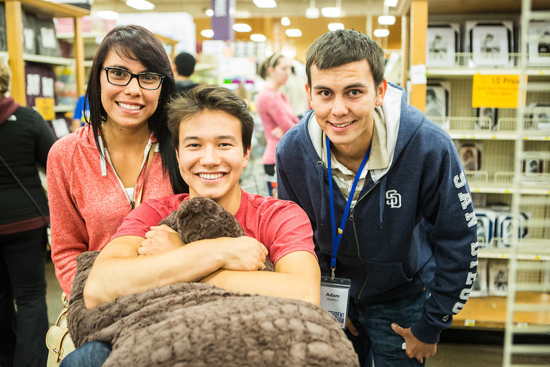 """From left, Sindy Mendez-Espino, Kelly C. May, and Adam Walters take a pause from shopping for a photograph during the Fred Meyer College Night shopping extravaganza.  <div class=""""ss-paypal-button"""">Filename: LIF-13-3926-35.jpg</div><div class=""""ss-paypal-button-end"""" style=""""""""></div>"""