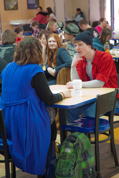 """Stephanie Sundberg, left, and Tyler McClendon perform a little """"flash theater"""" by running a scene from Theatre UAF's production of """"All in the Timing"""" during a busy time in the Wood Center food court.  <div class=""""ss-paypal-button"""">Filename: LIF-12-3325-38.jpg</div><div class=""""ss-paypal-button-end"""" style=""""""""></div>"""