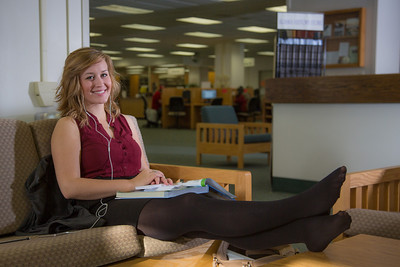 Music education major Anna Polum finds a comfortable spot to study in the Rasmuson Library.  Filename: LIF-13-3950-77.jpg