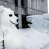 "The UAF mascot stares down the ice carving in front of the Gruening Building.  <div class=""ss-paypal-button"">Filename: LIF-14-4101-18.jpg</div><div class=""ss-paypal-button-end"" style=""""></div>"