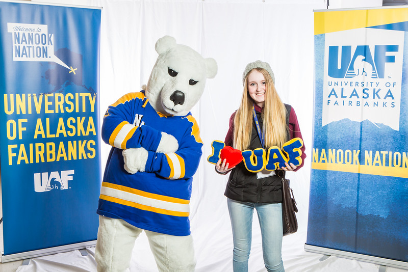 """Future UAF students and family members pose with the Nanook mascot during Inside Out.  <div class=""""ss-paypal-button"""">Filename: LIF-16-4839-80.jpg</div><div class=""""ss-paypal-button-end""""></div>"""