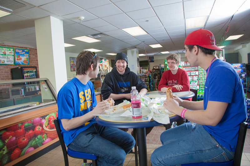 """Students Quinn Verfaillie, left, and Robert Doerning enjoy sandwiches in the Campus Cache, located in the Moore-Bartlett-Skarland residence hall complex on the Fairbanks campus.  <div class=""""ss-paypal-button"""">Filename: LIF-12-3339-40.jpg</div><div class=""""ss-paypal-button-end"""" style=""""""""></div>"""