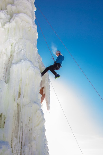 """Students take advantage of nice spring weather to try out their climbing skills on the new ice wall near the SRC.  <div class=""""ss-paypal-button"""">Filename: LIF-12-3321-025.jpg</div><div class=""""ss-paypal-button-end"""" style=""""""""></div>"""