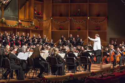Conductor Eduard Zilberkant leads the Fairbanks Symphony Orchestra and University Chorus in their annual holiday performance in the Davis Concert Hall.  Filename: LIF-12-3669-76.jpg
