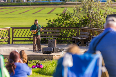 Local musician Ukulele Russ entertained a nice crowd during UAF Summer Session's free Music in the Garden concert series June 12.  Filename: LIF-14-4209-76.jpg