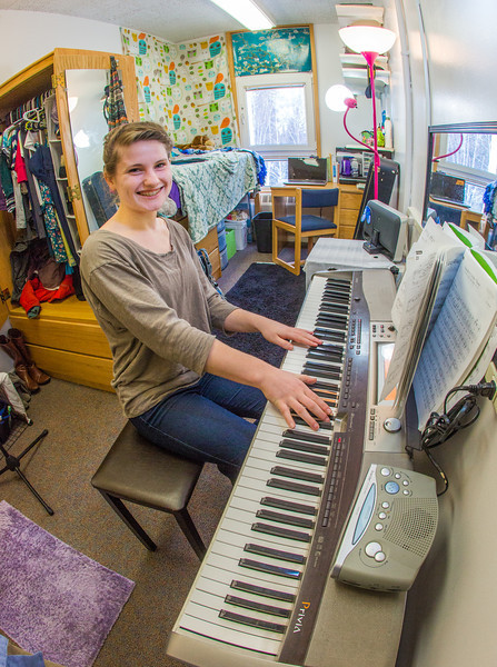 """Music major Kaylie Wiltersen practices the keyboard in her Skarland Hall single room.  <div class=""""ss-paypal-button"""">Filename: LIF-13-3735-82.jpg</div><div class=""""ss-paypal-button-end"""" style=""""""""></div>"""