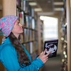 "Senior biology major Sarah Dewitt looks through the stacks on the 6th floor of the Rasmuson Library.  <div class=""ss-paypal-button"">Filename: LIF-14-4045-137.jpg</div><div class=""ss-paypal-button-end"" style=""""></div>"
